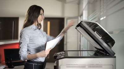 Girl Printing In The Office