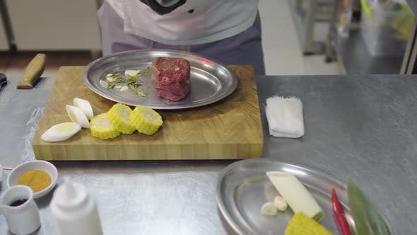 Thumbnail for Unrecognized Chef in Apron Pouring Raw Piece of Meat with Seasoning Before Baking in the Oven