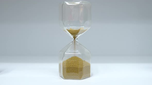 Thumbnail for Hourglass Close Up. Glass Hourglass with Small Balls Instead of Sand