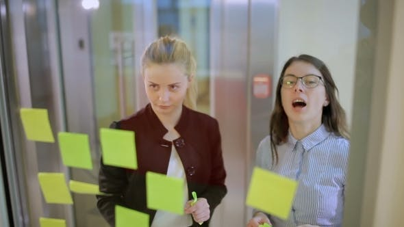 Thumbnail for Two Young Girls Discussing The Problem In The Office