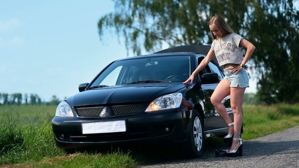 Thumbnail for Pretty Girl Inflating Car Tyre With Foot Pump