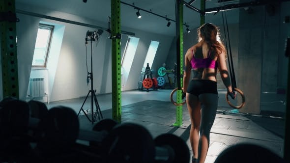 Thumbnail for Fitness Dip Ring Woman Workout At Dark Gym