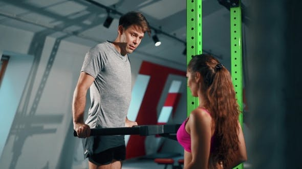 Thumbnail for Young Man And Personal Female Trainer In Gym