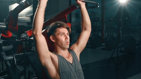 Thumbnail for Man Flexing Muscles On Gym Machine