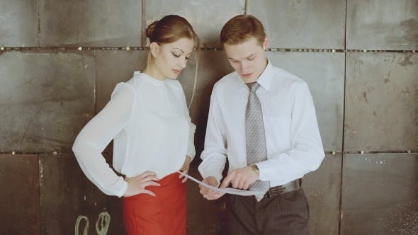 Thumbnail for Businessman And Businesswoman Discussing Business Report. Business Work