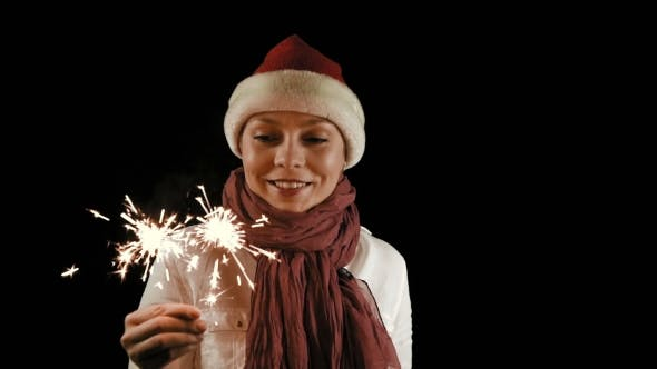 Thumbnail for Pretty Girl In Red Christmas Santa With Sparklers