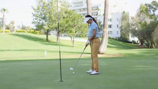 Thumbnail for Woman Golfer Lining Up For a Putt