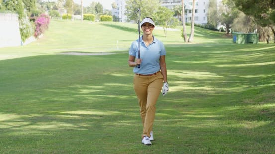 Thumbnail for Smiling Friendly Woman Golfer Walking On a Course
