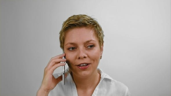 Thumbnail for Excited Blond Woman Emotionally Talking by Phone