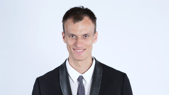 Thumbnail for Portrait of young happy smiling business man, white background