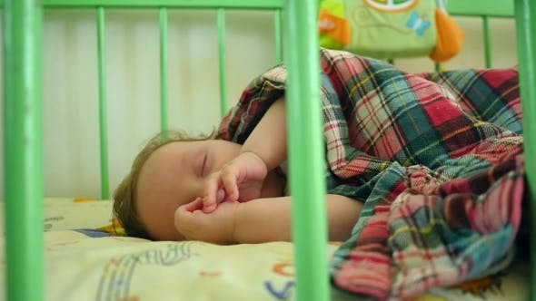 Thumbnail for Sleeping Baby Covered In The Crib