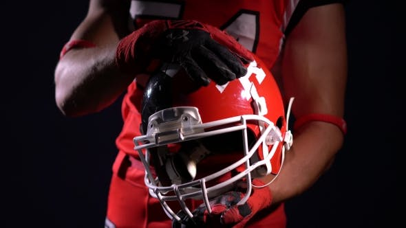 Thumbnail for American Football Player Holding Helmet
