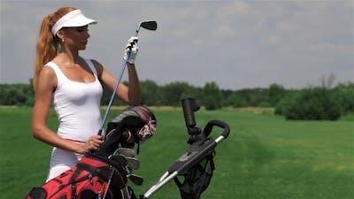 Woman Takes a Golf Club
