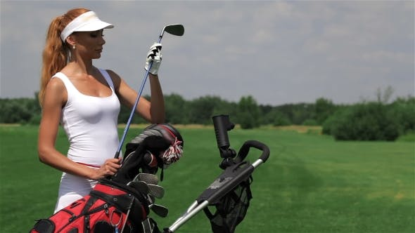 Thumbnail for Woman Takes a Golf Club