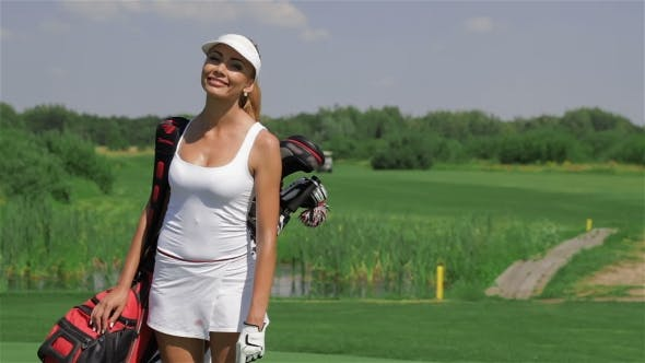 Thumbnail for Woman Carries a Golf Bag