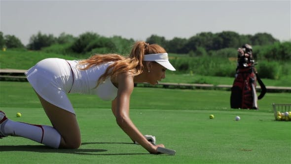 Thumbnail for Woman Looks At The Hole At The Golf Field