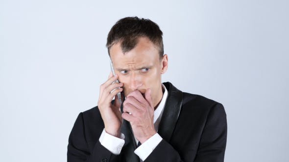 Thumbnail for Sad Businessman Worried while Talking on Phone