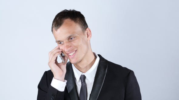 Thumbnail for Smiling Handsome Man Talking on Phone