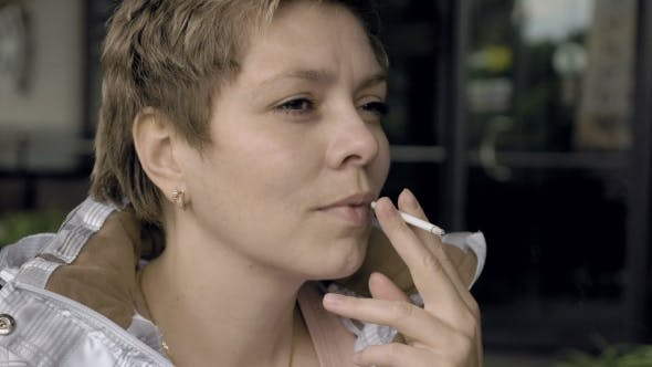 Thumbnail for Smoking Female With a Cigarette In Her Hand