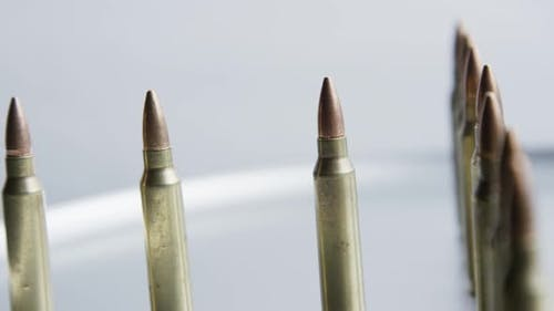 Cinematic rotating shot of bullets on a metallic surface - BULLETS 062