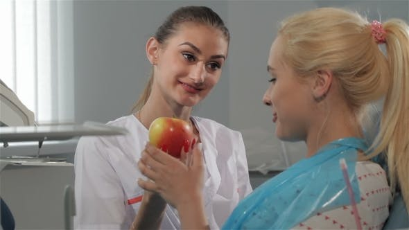 Thumbnail for Dental Surgeon Talks With Her Patient At The Dentist Cabinet