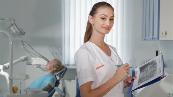 Thumbnail for Female Dentist Poses At The Dental Clinic