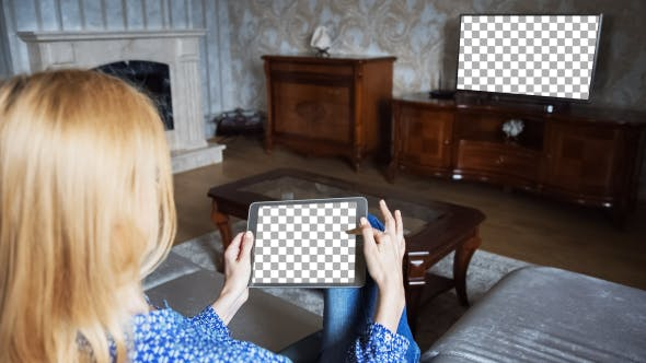 Thumbnail for Beautiful Girl Using Tablet PC with Isolated Screen Sitting on Sofa at Home 5 In Front Of The TV