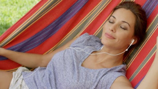 Thumbnail for Blissful Young Woman Relaxing Listening To Music