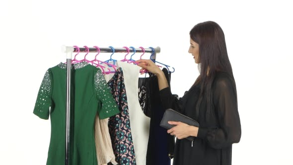 Cover Image for Elegant Woman Shopping In Clothes Store. White