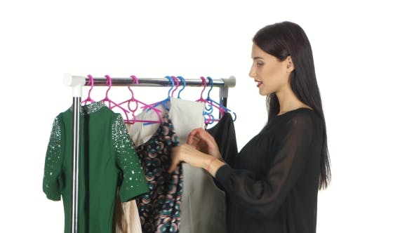 Thumbnail for Woman Shopping Clothes. Shopper Looking At Clothing Indoors In Store. White