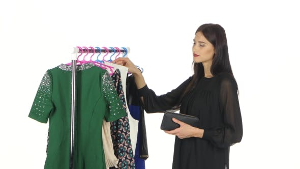 Cover Image for Woman Shopping For Clothes. White