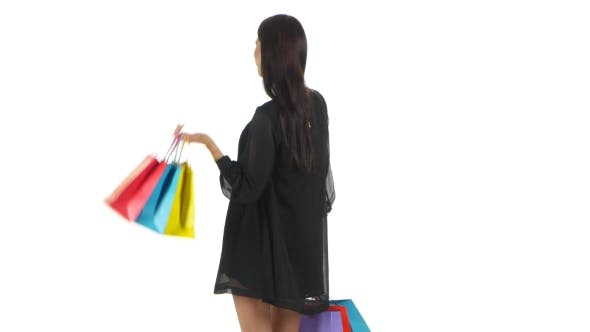 Thumbnail for Girl Holding Shopping Bags And Laughing And Smiling. White
