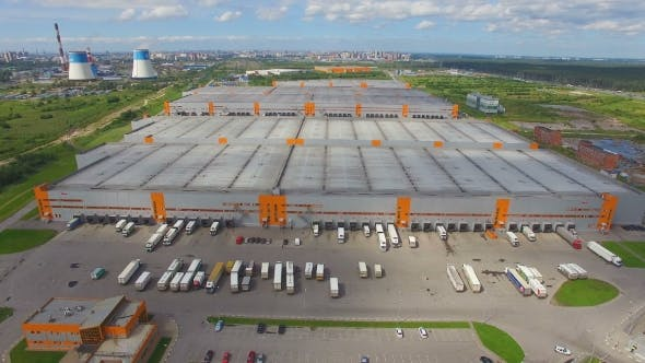Thumbnail for aerial view of the Distribution Warehouse With Trucks Of Different Capacity