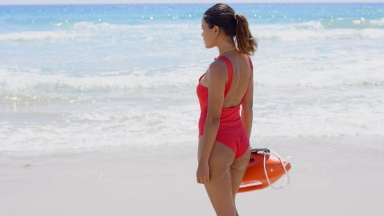 Thumbnail for Rear View On Lifeguard In Red With Buoy