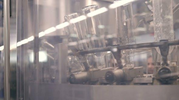 Thumbnail for Many Bottles Of Vodka Or Gin On Conveyor Belt In Factory. Bottling Plant