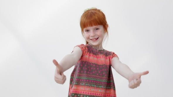 Thumbnail for Happy Little Girl Showing Thumb Up Gesture and Smiling