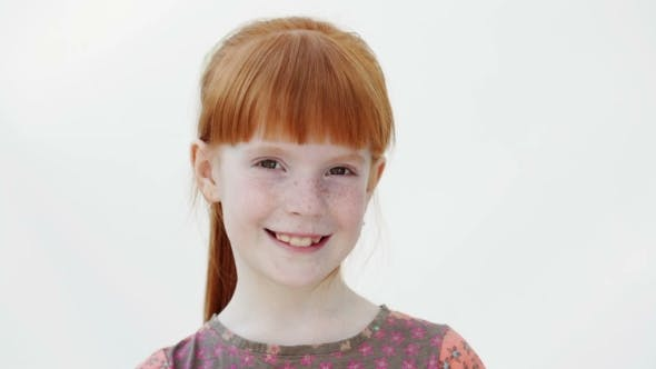 Thumbnail for Happy Little Redheaded Girl is Winking, White Background