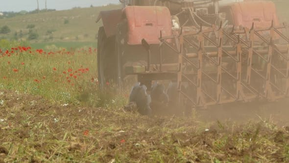 Thumbnail for Tractor Cutting Field With Weeds
