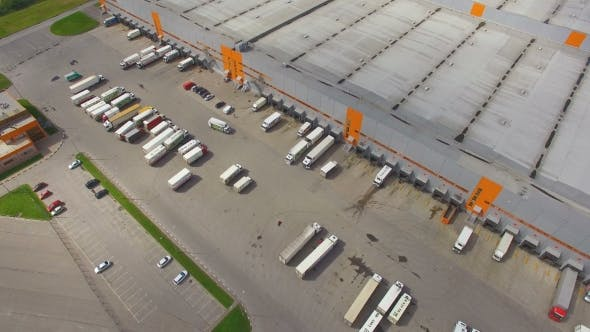 Thumbnail for Aerial view of the logistics warehouse with trucks waiting for loading