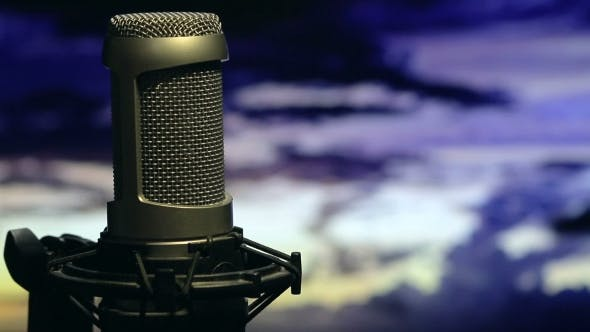Cover Image for Isolated Microphone On Stand Background Cloudy Sky