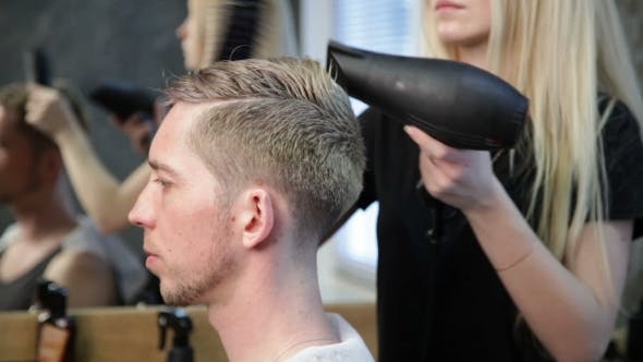Thumbnail for Woman Barber Drying Man's Head