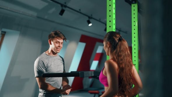 Thumbnail for Young Man And Personal Female Coach In Gym