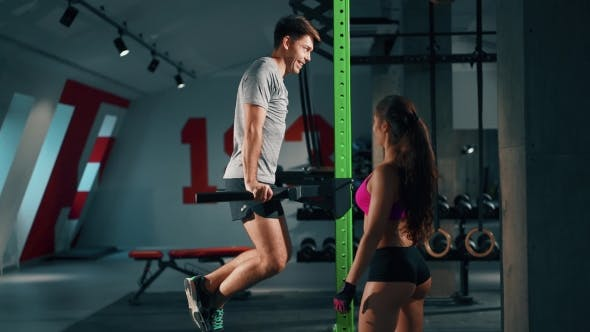 Thumbnail for Sporty Man And Personal Female Trainer In Gym