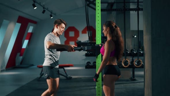 Thumbnail for Handsome Man and Personal Female Trainer in Gym