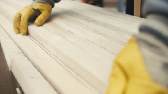 Thumbnail for Man Working With Wood At Sawmill