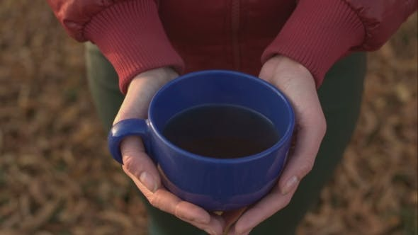 Thumbnail for Female Hands Hold a Large Blue Cup