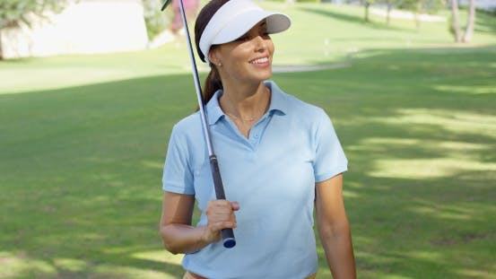 Thumbnail for Young Woman Golfer Strolling Across The Course
