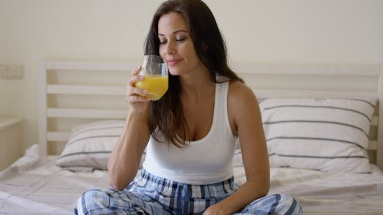 Thumbnail for Young Woman Enjoying a Glass Of Orange Juice