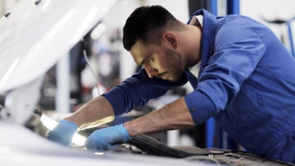 Cover Image for Mechanic Man With Wrench Repairing Car At Workshop 25