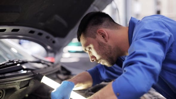 Thumbnail for Mechanic Man With Wrench Repairing Car At Workshop 2